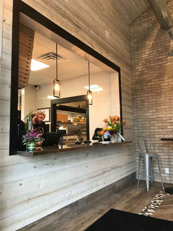 Restaurant decor with rustic wood panels [Easy Barnwood Collection from Great American Spaces]