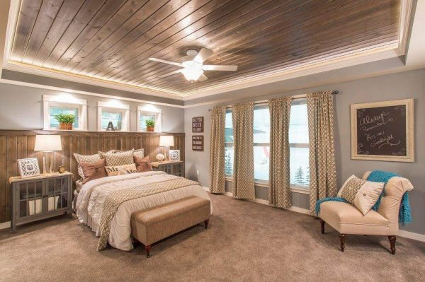 Rustic meets modern master bedroom with dark wood planks and gray paint [Easy Barnwood Collection from Great American Spaces]