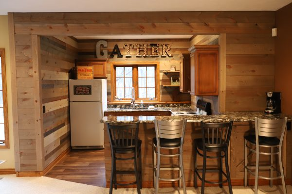 Kitchenette using Great American Spaces Easy BarnWood and Mixed BrewPub for wood wall coverings