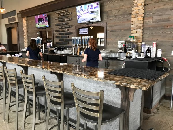 Brewery and Restaurant using Great American Spaces Easy BarnWood in Old Barn Gray to line the bar wall and taps